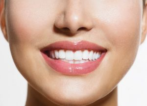 Healthy Smile. Teeth Whitening. Smiling Young Woman
