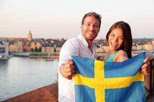 Swedish people showing Sweden flag in Stockholm